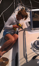 Photo: Anne countersinking the holes and adding buty-tape to the deck rail fasteners