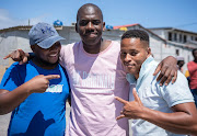 Siyabulela Sophi (M) with two of his customers.