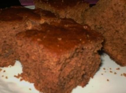 Preheat the broiler. Spoon the glaze over the top of the cake, allowing the...