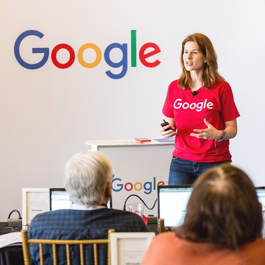 A Google employee leading an in-person Google training for small businesses.