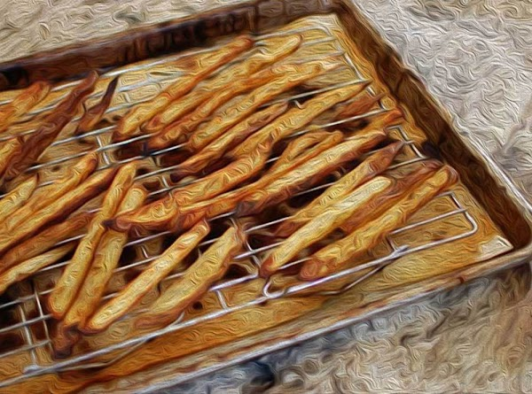 Place a cooling rack on a baking sheet, and put the chips on it...
