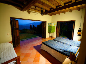 Photo: This is one of the guest rooms at the Finca. The walls open up to the outdoors and you can see Colombia's natural beauty for miles.
