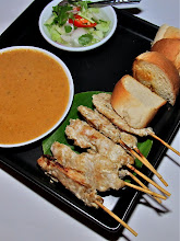 Photo: pork satay with peanut sauce and cucumber relish