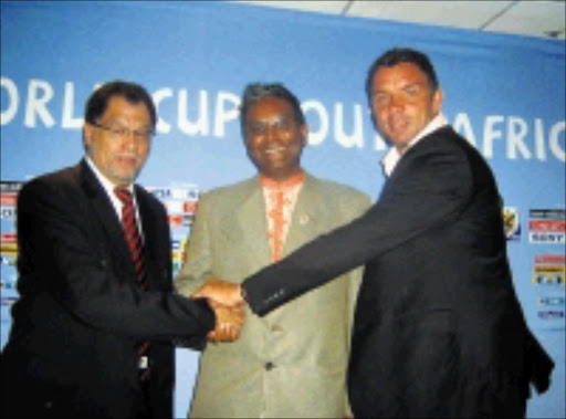 UNITED: National Lottery Distribution's Serhan Naidoo is sandwiched by Danny Jordaan, LOC's chief executive officer, and soccer legend Mark Fish at a media briefing yesterday. 06/04/09. Pic. Ramatsiyi Moholoa. © Sowetan.
