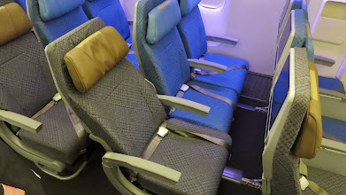 Photo: Economy seat in recline position on Singapore Air's new B777-300ER