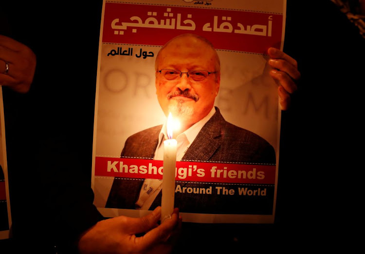 A demonstrator holds a poster with a picture of Saudi journalist Jamal Khashoggi outside the Saudi Arabia consulate in Istanbul, Turkey, on October 25 2018.