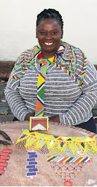 Yolisa Fuma wearing some of the beadwork that she produces.