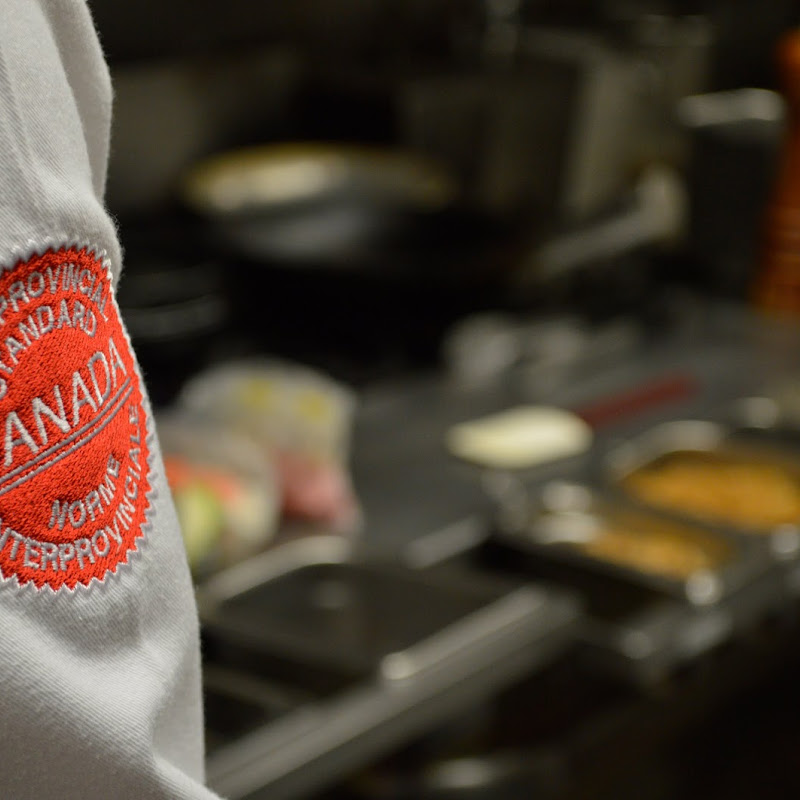 Shot of a chef's sleeve with the Red Seal certification emblem