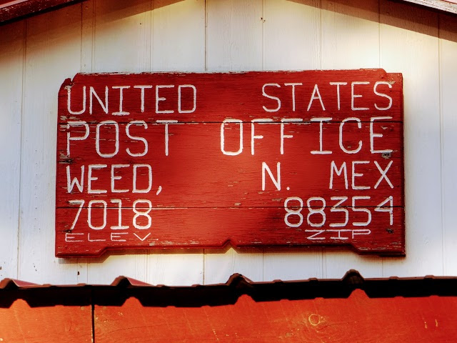 Weed, NM post office sign