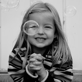 Looking-Bubble by Jesse Hebert - Babies & Children Child Portraits ( child, girls, bubble, blonde, little girl, girl, black and white, beautiful, bubbles, little, children, cute )