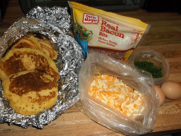 Remove corn cake from oven; place/sprinkle bacon on top of corn cake.