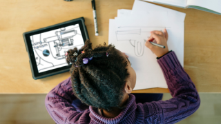 image of young girl drawing on paper