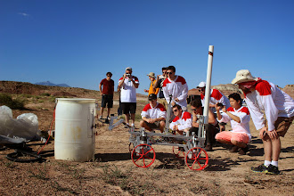 Photo: The Queen's Space Engineering Team (Queen's University Canada) team looks on in eager anticipation as their rover begins work at the Equipment Servicing Task.