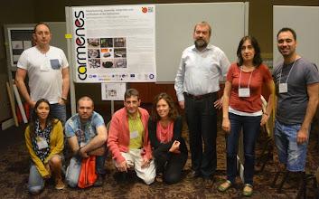 "Photo: CARMENES team members at ""Cool Star 18"" #cs18 with one of the CARMENES posters. http://carmenes.caha.es/ext/conferences/CARMENES_CS18_Quirrenbach.pdf"