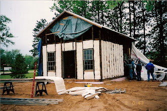Photo: Adding insulation from the outside.