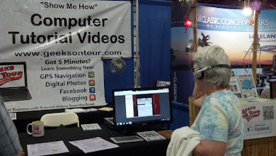 Photo: Someone watching a tutorial video at our booth.