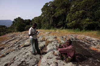 Photo: On a rock outcrop - taking a break and notes.