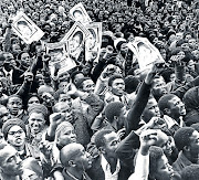 Black South Africans at the funeral service of anti-apartheid activist Steve Biko