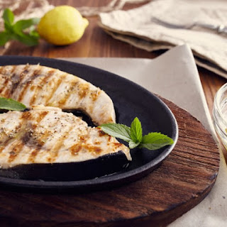 Grilled Swordfish with Lemon Juice, Olive Oil and Herbs.