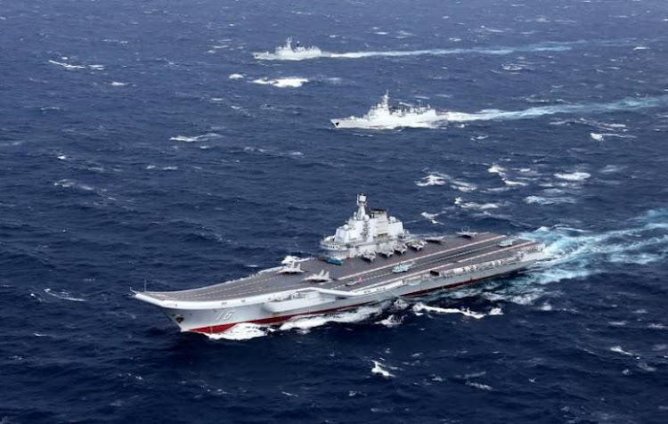 China's Liaoning aircraft carrier with accompanying fleet conducts a drill in an area of South China Sea. Picture: REUTERS