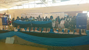 Pictures of the  18 victims of the Verana crash on stage at their memorial in Sokhulumi community hall in Verena Picture: Boikhutso Ntsoko
