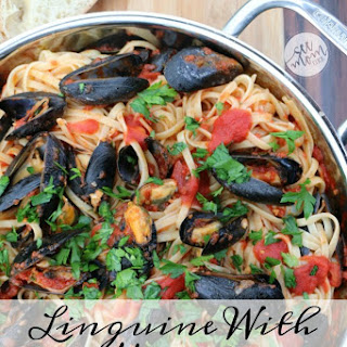 Linguine With Mussels In Tomato Sauce.