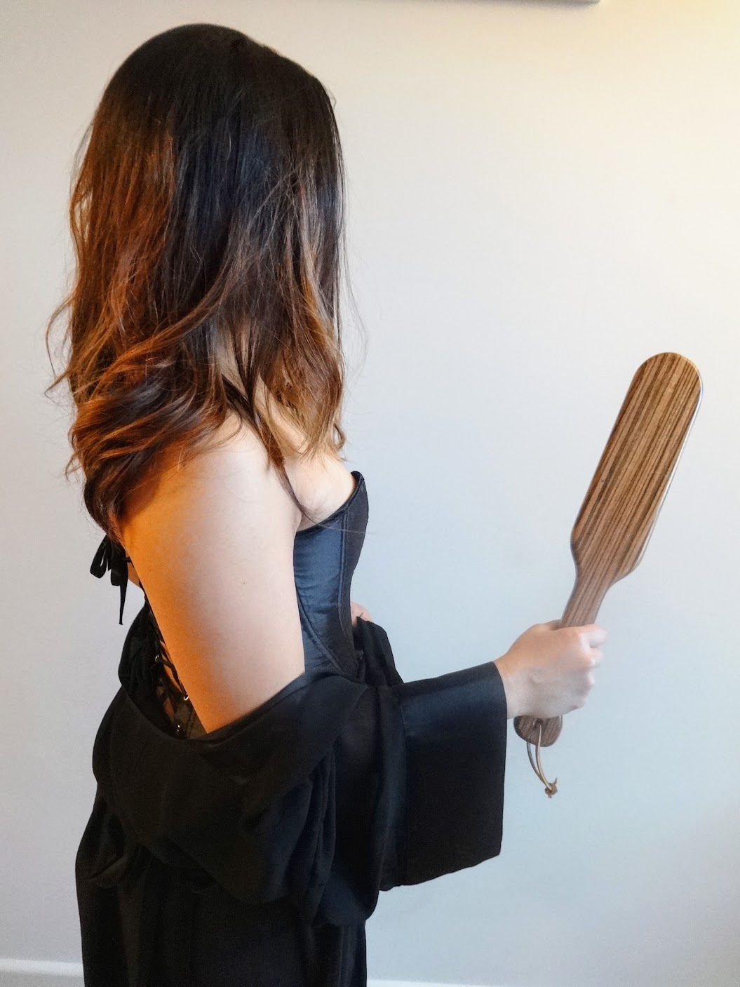Asian domme in San Francisco with wooden paddle