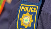 One of the cash heist suspects claimed she had to get medical attention after being assaulted by a police officer.