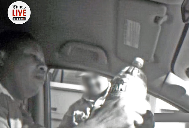 A screengrab from the video showing Nomia Rosemary Ndlovu, a former policewoman, passing a two-litre bottle of petrol to an undercover police officer.