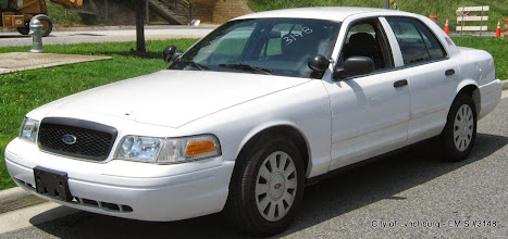 Photo: Lot 24 - (3148-1/1) - 2010 Ford Crown Victoria - 100,082 miles