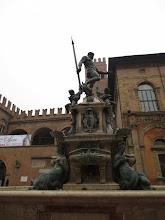 Photo: A statue of Neptune and his mermaids in Piazza Maggiore