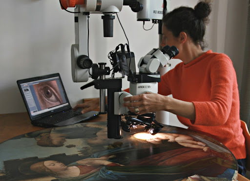 Condition examination of a painting under the stereomicroscope