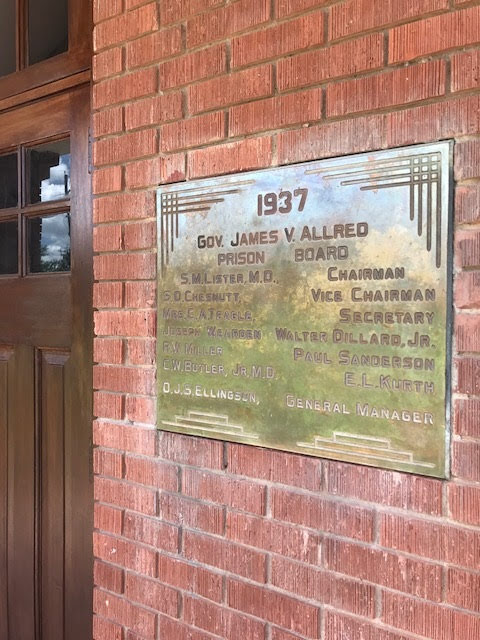 1937 Plaque Restored to Former Prison Building