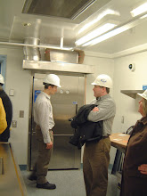 Photo: Typical view inside BSL3 laboratory space - autoclave in background