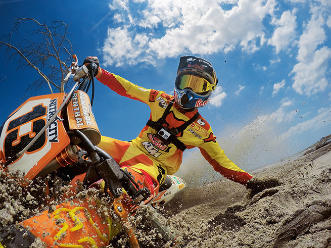 An image of an extreme sports dirt bike rider on a dirt bike to represent the Red Bull and GoPro brand partnership
