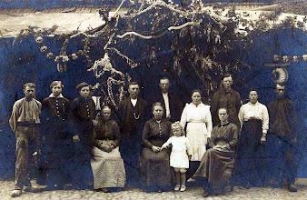 """Photo: Opbouw feesttent bij café """"De Rustende Jager"""" ± 1914 v.l.n.r. zittende: Aaltje Heersping-Lanjouw, Grietje Speelman-Homan, Henderika Speelman en Jantje Kleef. Staand: Albertus Lanjouw, Henderkien Heersping, Roelfien Heersping, Harm Speelman, Freerk Homan, Roelfien Lanjouw, Harm Homan, Grietje Rozenveld en Lute Enting  Henderkien Heersping is later getrouwd met Geert Wilberts, Roelfien Heersping mat Arent Okken."""