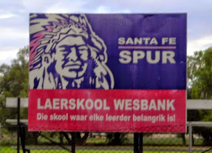 Photo: Walking by a high school near our hotel, I was puzzled by this sign. Why would a school or company in South Africa have a Native American as a mascot? But ... (see the next photo)
