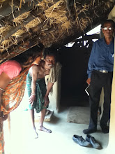 Photo: Mr Mohanty, ADIRE conference attendee visiting another house where solar homelight donated by Mr Suri Chekuri was installed