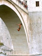 Photo: Mostar - Old Bridge, a man jumping into the Neretva river