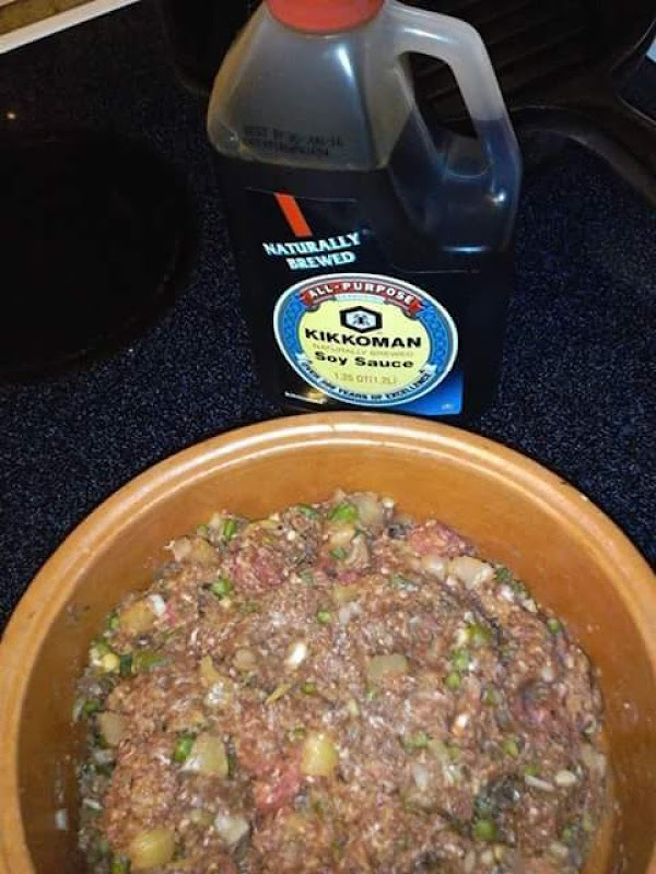 Season meat with salt, pepper, garlic salt and soy sauce (the more meat, the...