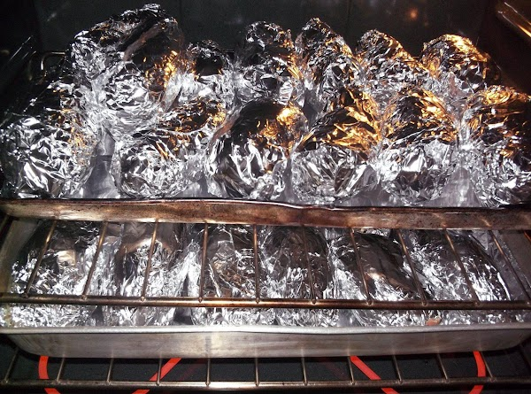 Place wrapped potatoes on a foil-lined baking sheet and place into hot oven. Bake...