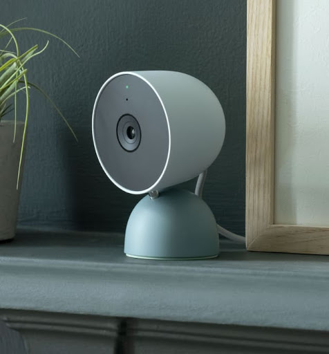 Nest Cam is on a shelf indoors.