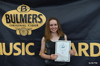 Photo: with one of her many certificates and cheques!