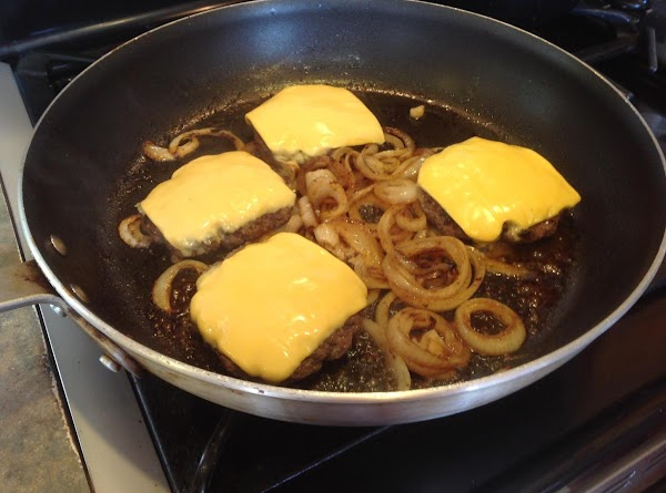 When burgers  are just about done add sliced cheese to each burger as...