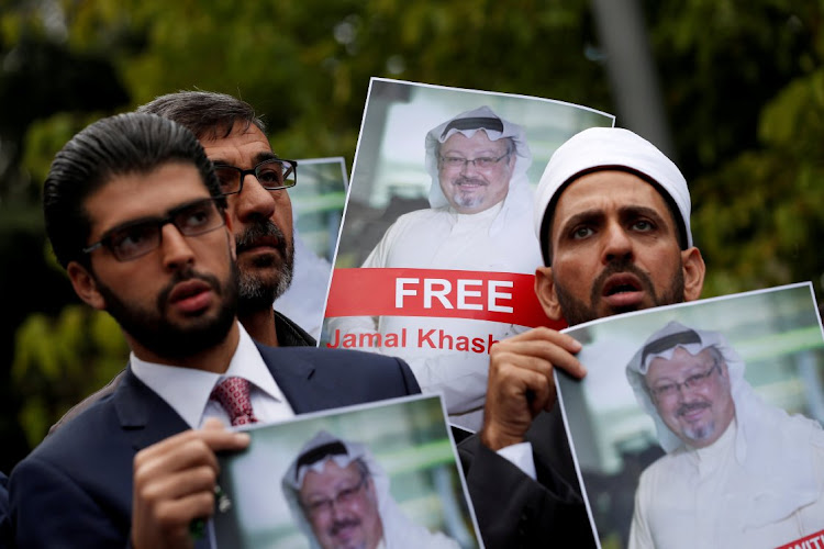 Human rights activists and friends of Saudi journalist Jamal Khashoggi hold his pictures during a protest outside the Saudi Consulate in Istanbul, Turkey on October 8 2018. Picture: REUTERS/Murad Sezer