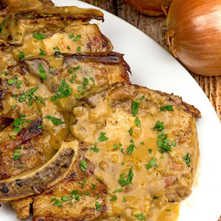 Herb Braised Pork Chops with Creamy Onion Gravy