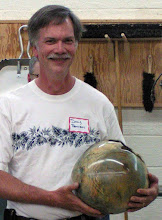 Photo: Doug Pearson with another of his amazing colored, large, hollow vessels.