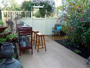 Photo: On the right: existing fuschia and rhododendron. Little area for seating on right just inside gate. (better seating to come!)