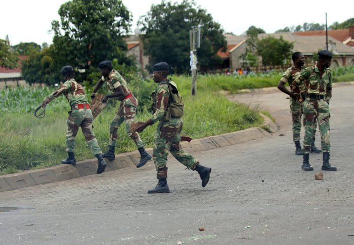 Soldiers patrolling streets in Zimbabwe amid civil unrest over a massive spike in fuel prices January 14-16, 2019
