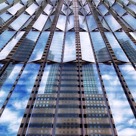 Looking up by Rosemary Gamburg - Buildings & Architecture Architectural Detail ( #reflections #architechturaldetail #skyreflection #windows #blue )